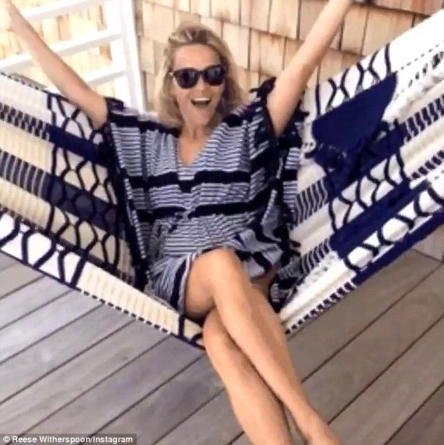 'This right now': Reese Witherspoon was certainly taking it easy on Thursday as shared a video of her swinging in a hammock