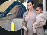 Mandatory Credit: Photo by Kristin Callahan/ACE/REX Shutterstock (5088103h)  Kim Kardashian and North West  Kim Kardashian out and about, New York, America - 16 Sep 2015