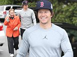 Beverly Hills, CA - Handsome actor Mark Wahlberg puts a protective hand over his grandmother as she accompanies him to the local Bristol Farms to grab some groceries on a chilly Sunday afternoon.  Mark was recognized by a few admirers and he greeted them with a big smile as he made his way out the door. \n  \nAKM-GSI         November 15, 2015\nTo License These Photos, Please Contact :\nSteve Ginsburg\n(310) 505-8447\n(323) 423-9397\nsteve@akmgsi.com\nsales@akmgsi.com\nor\nMaria Buda\n(917) 242-1505\nmbuda@akmgsi.com\nginsburgspalyinc@gmail.com