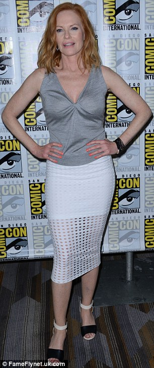 Showing off:Marg rocked a sleeveless grey top, perforated white skirt along with beige and black leather heels