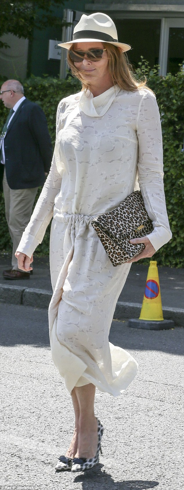 Fashion designer Stella McCartney showed off her wild side in a pair of leopard print high-heeled shoes