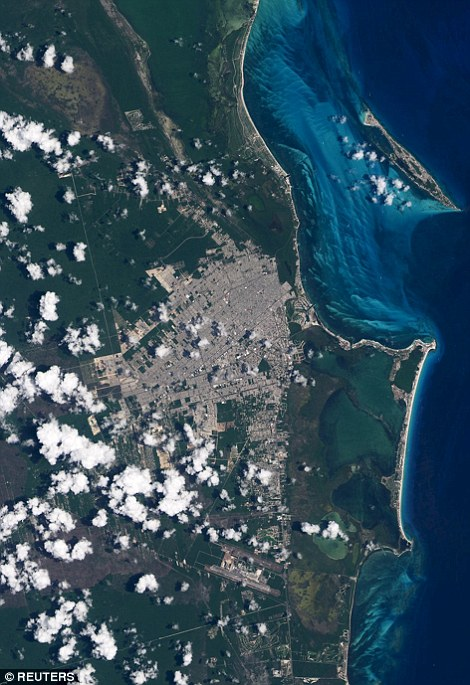 The coastline of Cancun in Mexico is seen in a combination of NASA satellite images taken in 1988 and in 2015