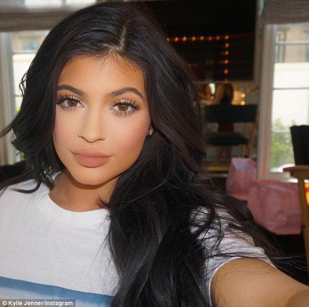 Kylie Jenner told her 28.5 million Instagram followers that she's set to share her 'beauty secrets' on her new website