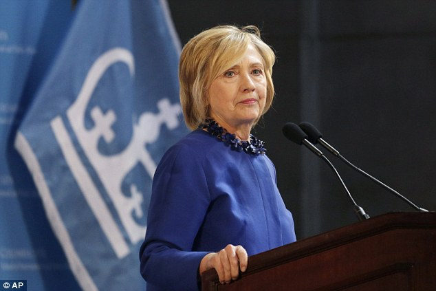 Democratic presidential candidate Hillary Clinton says a wave of unrest in Baltimore shows that our criminal justice system is 'out of balance' and is in 'urgent need' of reform