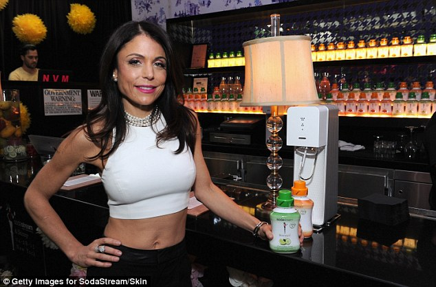 Always representing the brand: The star - who recently threw a brunch using her Skinnygirl goods on RHONY - showed off the two new flavors as she stood by a Soda Stream machine