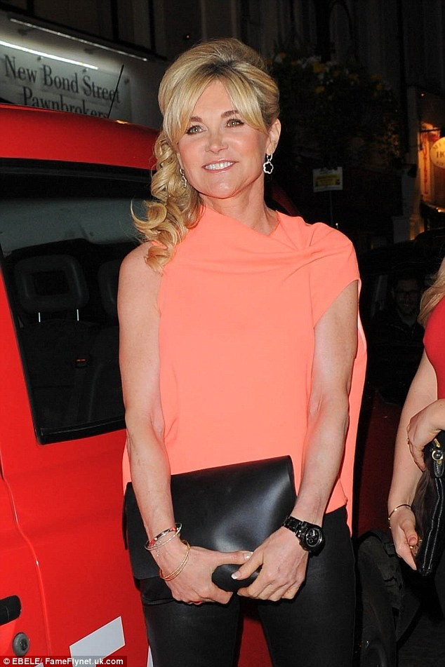 Youthful: Anthea Turner turned heads in a fluorescent orange top and leather leggings