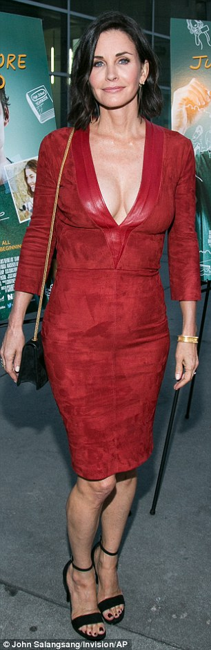 Glamour girl: Courteney sizzled in a plunging red suede Jitrois Paris dress and posed for photos