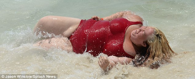 Whoops! June took a tumble when she was knocked over by a wave but managed to see the funny side