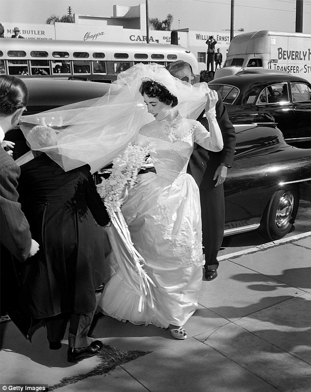 Iconic design: The satin ball gown featured a high-neck silhouette similar to the ones worn by Grace and Nicky