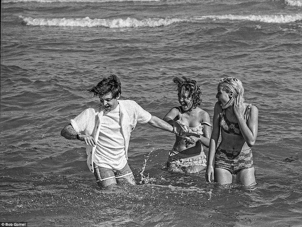 Beatlemania: Some lucky ladies also got to get in on the action when Paul went for a dip in the ocean