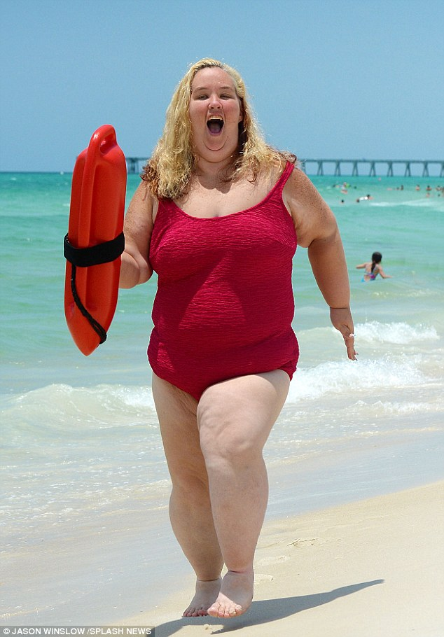 On the run: Mama June had a Baywatch moment on Wednesday when she hit the beach in Florida in a red bathing suit