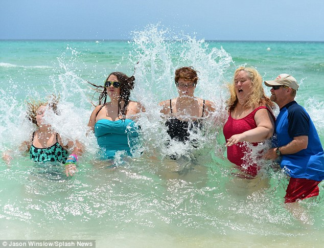 Yikes: Mama June didn't seem to enjoy being battered by waves as the group posed for pics