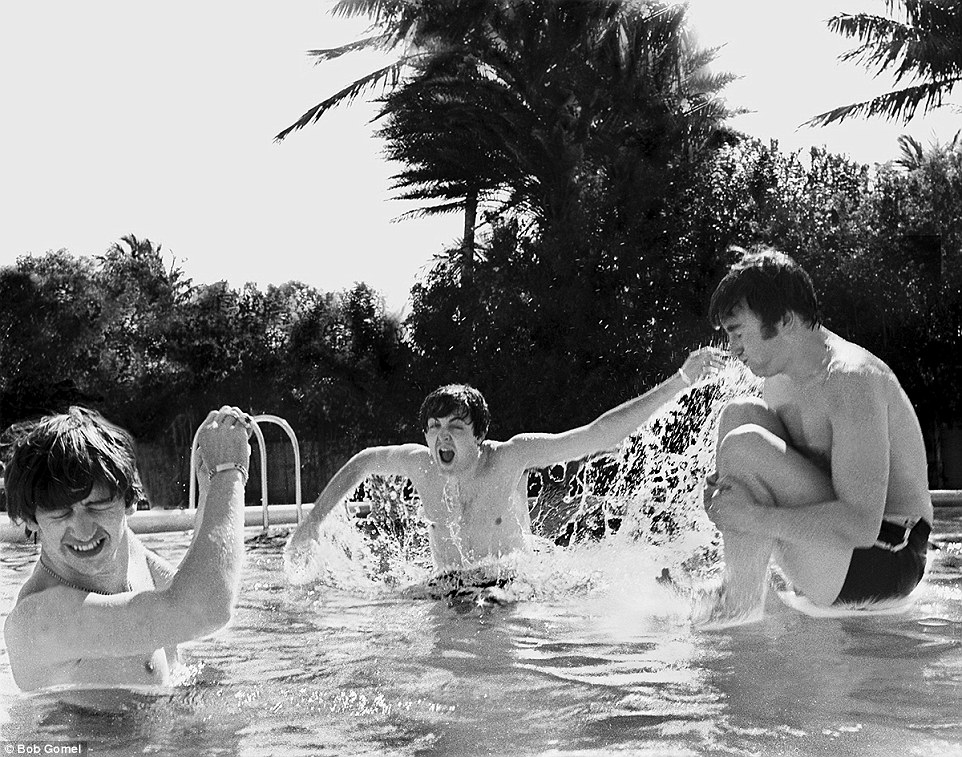 Bombs away: John Lennon prepares to hit the water in one of the poolside picture that were shot for Life but never ran in the magazine, only now being released