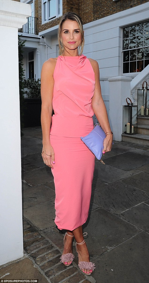 Striking display: The blonde beauty looking seriously stunning in a salmon pink dress