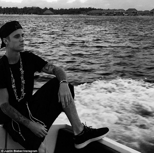 The sad ex: Justin Bieber on a boat during one of his many vacations; he split from the brunette in 2014