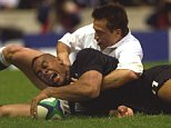 LOMU...New Zealand's winger Jonah Lomu scores a try against England during their Pool B Rugby World Cup match at Twickenham, in west London Saturday October 9, 1999. (AP Photo/Adam Butler)...S...RUG