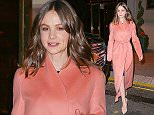 EXCLUSIVE: Carey Mulligan is all smiling while wearing a coral wrap coat in New York City  Pictured: Carey Mulligan Ref: SPL1178890  171115   EXCLUSIVE Picture by: Felipe Ramales / Splash News  Splash News and Pictures Los Angeles: 310-821-2666 New York: 212-619-2666 London: 870-934-2666 photodesk@splashnews.com