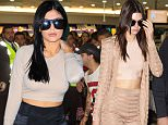 EXCLUSIVE: Kendall and Kylie Jenner depart Melbourne airport.\nKendall and Kylie Jenner are seen walking through Melbourne airport heavily guarded by security as they head for their departing flight after a 2 day promotional tour of Australia.\nKendall wore a beige/tan colour top and pants with a matching jacket and matching high heels as she made her way through the airport, while her sister Kylie opted for a more casual beige/tan coloured top with black pants.\nBoth Kendall and Kylie seemed to be wearing no bra again for the second time in two days.\n\nPictured: Kendall Jenner\nRef: SPL1179370  191115   EXCLUSIVE\nPicture by: Splash News\n\nSplash News and Pictures\nLos Angeles: 310-821-2666\nNew York: 212-619-2666\nLondon: 870-934-2666\nphotodesk@splashnews.com\n