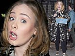 """18.NOVEMBER.2015 - NEW YORK - USA ADELE PUTS HER NEW YORK FANS ON HOLD AS SHE CARRIES A PACKAGE TO HER CAR BEFORE STOPPING TO TAKE PHOTOS WITH FANS IN DOWNTOWN MANHATTAN, NEW YORK. ADELE HEADS FOR A DINNER AT THE """"SPOTTED PIG"""" RESTAURANT IN THE WEST VILLAGE, NYC. BYLINE MUST READ : XPOSUREPHOTOS.COM ***UK CLIENTS - PICTURES CONTAINING CHILDREN PLEASE PIXELATE FACE PRIOR TO PUBLICATION*** UK CLIENTS MUST CALL PRIOR TO TV OR ONLINE USAGE PLEASE TELEPHONE 0208 344 2007"""