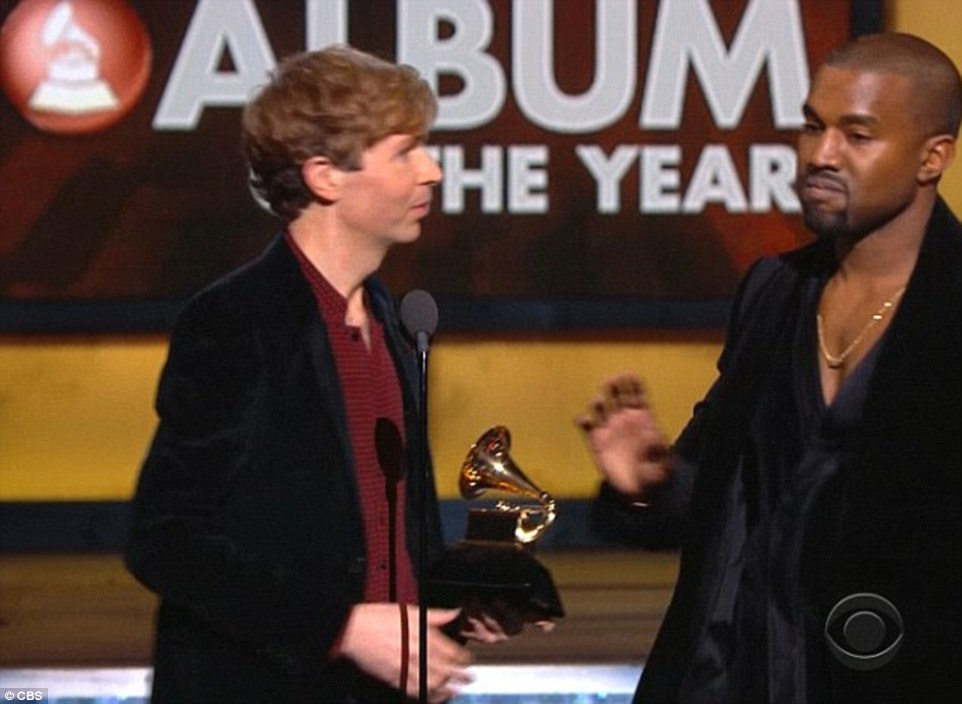 While he was receiving the award, Kanye West stormed on stage and told him he should have given it to Beyonce for her self-titled 2013 album