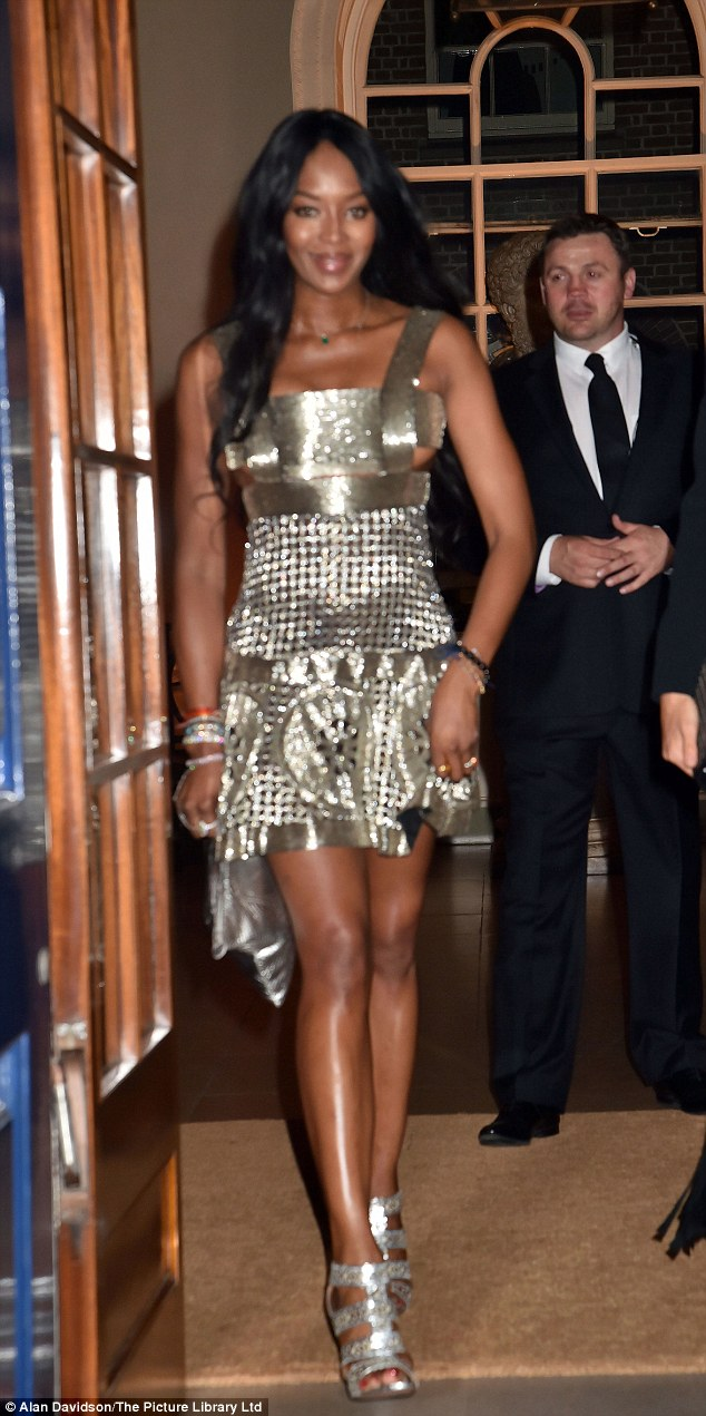Guest of honour: Naomi Campbell glittered in metallic mini dress at Nicky Hilton's pre-wedding party in London