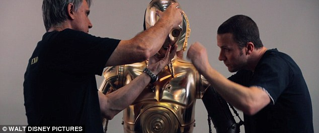 Golden: Crew members are shown putting together the C-3PO humanoid robot