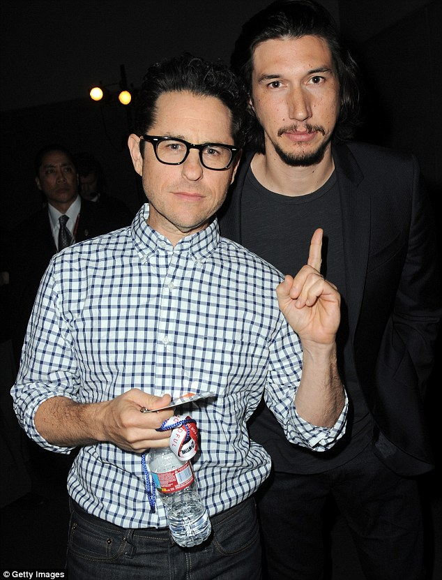 Men's men: The whiff of testosterone was unmistakable as JJ posed for a photo with hunk Adam Driver