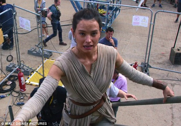 British beauty: Daisy Ridley, 23, is shown a few times in the clip as she is shown climbing up the stairs to fly one of the franchise's signature spacecrafts