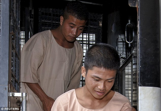 Accused: Burmese migrant workers Zaw Lin (right) and Win Zaw Htun (left) arrive at Koh Samui Provincial Court this morning. The pair initially confessed to the murder but have since retracted their statements