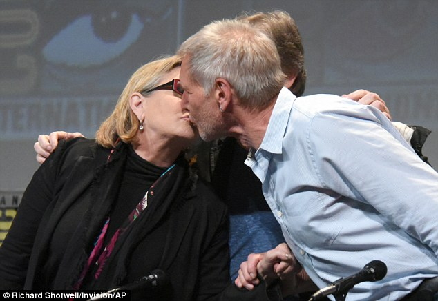 Look away, Calista! Carrie Fisher and Harrison Ford kissed in front of the 6K-strong Star Wars fans packed into Comic-Con's historic Hall H on Friday