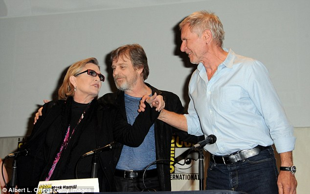 Three's a crowd! Their heated, cathartic reunion happened in San Diego during The Force Awakens's official panel, which revealed behind-the-scenes footage