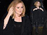 NEW YORK, NY - NOVEMBER 19:  Singer Adele is seen walking in the rain in Soho on November 19, 2015 in New York City.  (Photo by Raymond Hall/GC Images)