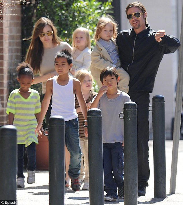 Big brood: The stars have six children and Brad says he loves the constant noise in their home