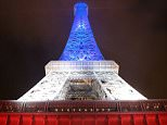 A picture taken on November 20, 2015 in Paris shows the Eiffel Tower illuminated with the colours of the French flag in tribute to the victims of the Paris's terror attacks on November 13, 2015 .  AFP PHOTO / LUDOVIC MARINLUDOVIC MARIN/AFP/Getty Images