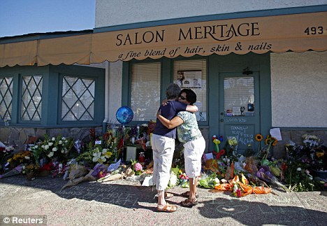 Emotional: Mourners pay their respects at the Salon Meritage hair salon in Seal Beach one day after a gunman opened fire and killed eight people