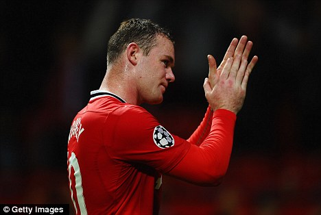 Appreciative: Rooney applauds the crowd for their patience at Old Trafford