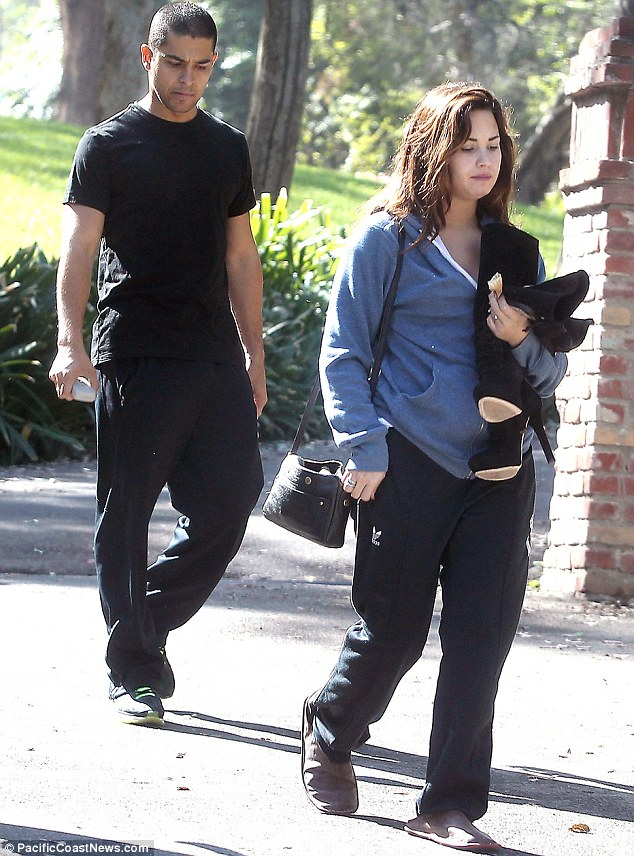 What's he looking at? Hunky Wilmer kept his eyes on Demi's back as he walked her to his car