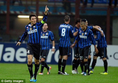 Zan hails fans: Javier Zanetti salutes the Inter supporters after scoring against Lille