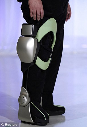 High-tech healthcare: Fujita Health University Professor Eiichi Saito demonstrates the prowess of the Independent Walk Assist robot during a news conference in Tokyo