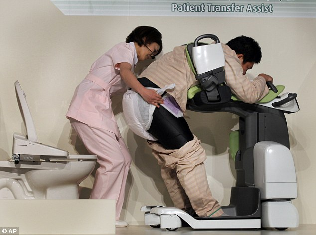 The future of healthcare? A demonstration shows how the robots help patients use the toilet, with a little assistance from a nurse