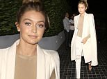 West Hollywood, CA - Gigi Hadid flashes a smile as she arrives for a dinner party with her Kardashian friends at Cecconi's in West Hollywood. The 20-year-old model looked classy in a white coat over a beige top, ripped skinny white jeans and a pair of nude high heels.\nAKM-GSI         November 19, 2015\nTo License These Photos, Please Contact :\nSteve Ginsburg\n(310) 505-8447\n(323) 423-9397\nsteve@akmgsi.com\nsales@akmgsi.com\nor\nMaria Buda\n(917) 242-1505\nmbuda@akmgsi.com\nginsburgspalyinc@gmail.com