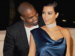 LOS ANGELES, CA - NOVEMBER 01:  Kanye West and Kim Kardashian West arrive at the 2014 LACMA Art + Film Gala Honoring Quentin Tarantino And Barbara Kruger at LACMA on November 1, 2014 in Los Angeles, California.  (Photo by Jon Kopaloff/FilmMagic)