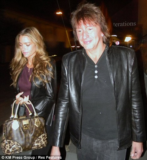 Smiles better: Richie looks content as the couple leave the restaurant, while Denise looks concerned to be rumbled