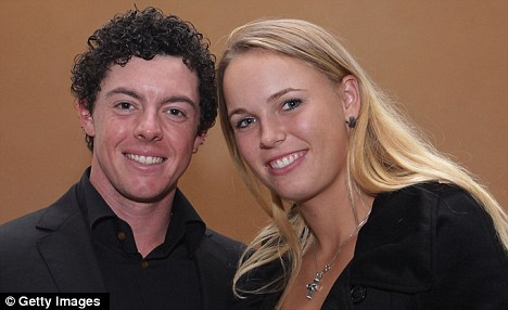 Love match: McIlroy and tennis girlfriend Caroline Wozniacki, who is watching him play for the first time this week