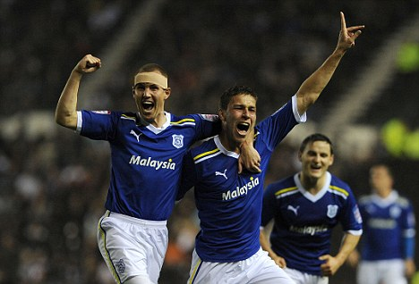 Filip's fillip: Kiss (centre) celebrates his opener for Cardiff with team-mate Kenny Miller (left)