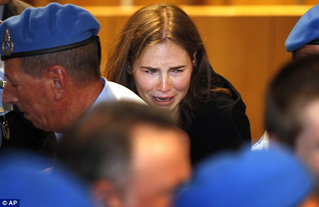 Overcome: Knox breaks down in tears after hearing the verdict that overturned her conviction
