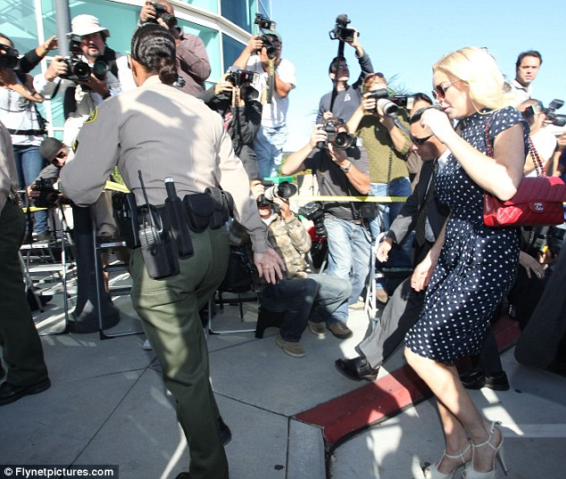 Ready for her close up: The media gathered outside the courtroom to capture the star's arrival