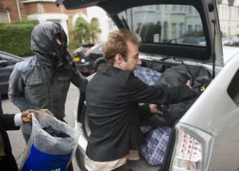 Not homeless: Squatters loading up a car after leaving a house in Burrand Road, West Hampstead last month