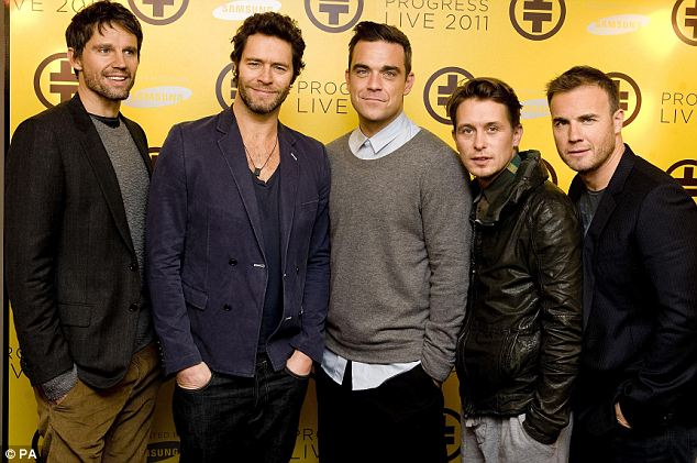 On song: Barlow with fellow Take That members (left to right) Jason Orange, Howard Donald, Robbie Williams and Mark Owen