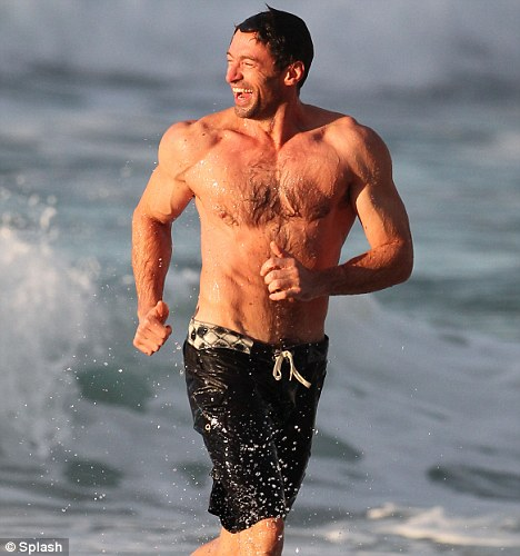 Super fit: Hugh Jackman, 42, at Bondi Beach in Sydney last week, showing off his enviably taut upper body